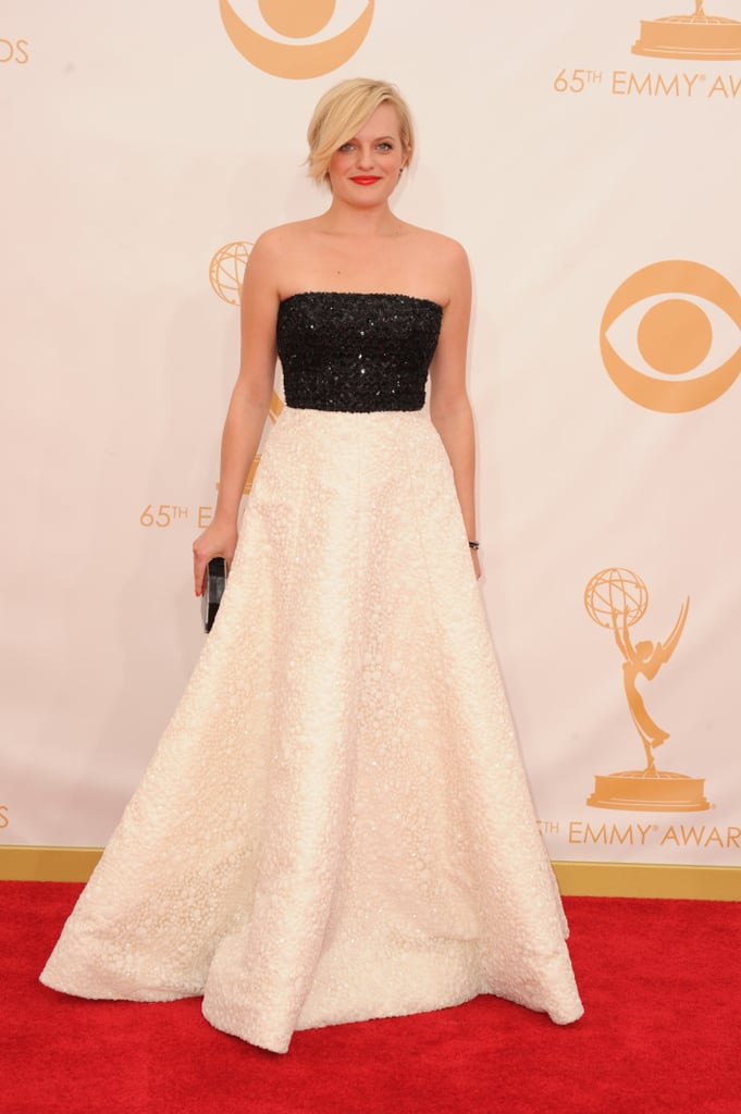 Elisabeth Moss, in a two-tone Andrew Gn dress, clearly couldn't settle for a single shade! She finished it off with vintage Neil Lane jewellery and a Rauwolf bag.