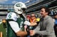 Jimmy Fallon greeted Mark Sanchez on the sidelines before a New York Jets game in October 2011.