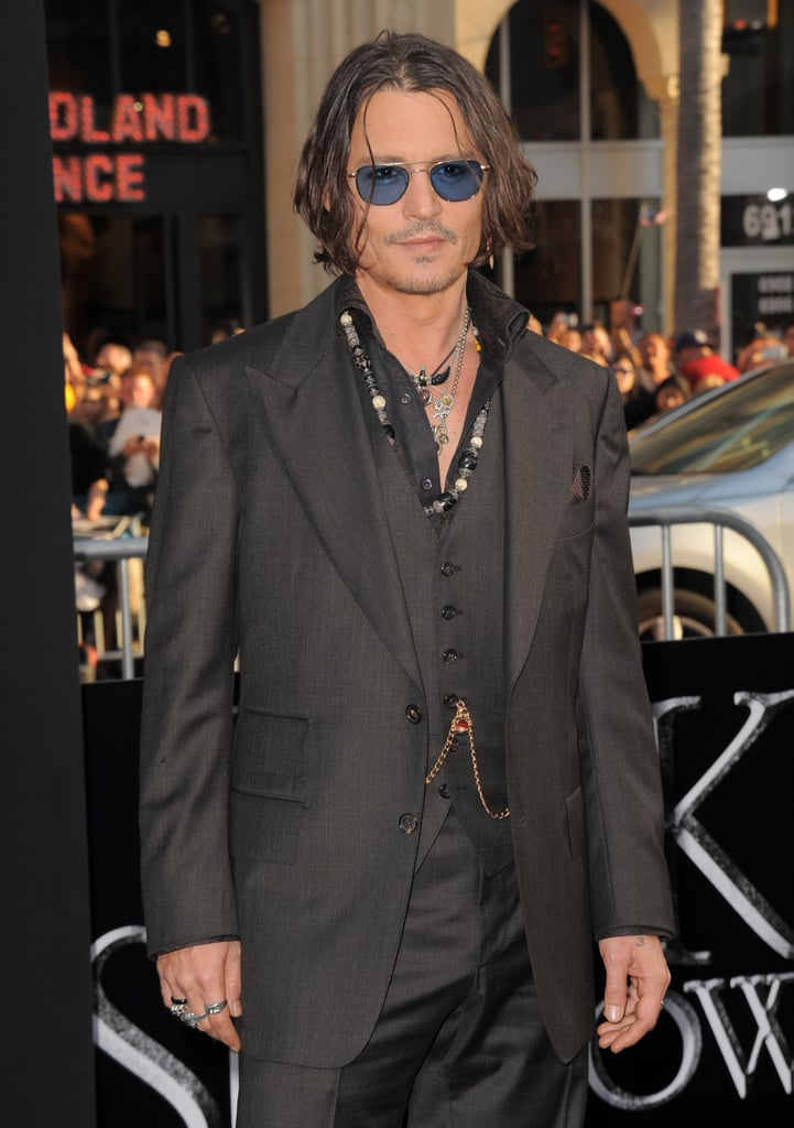 Johnny Depp stepped onto the black carpet in a black three-piece suit for the Dark Shadows premiere in LA.