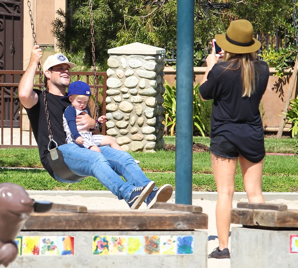 Hilary Duff snapped photos of her husband, Mike Comrie, and their son, Luca, playing at a park in LA.