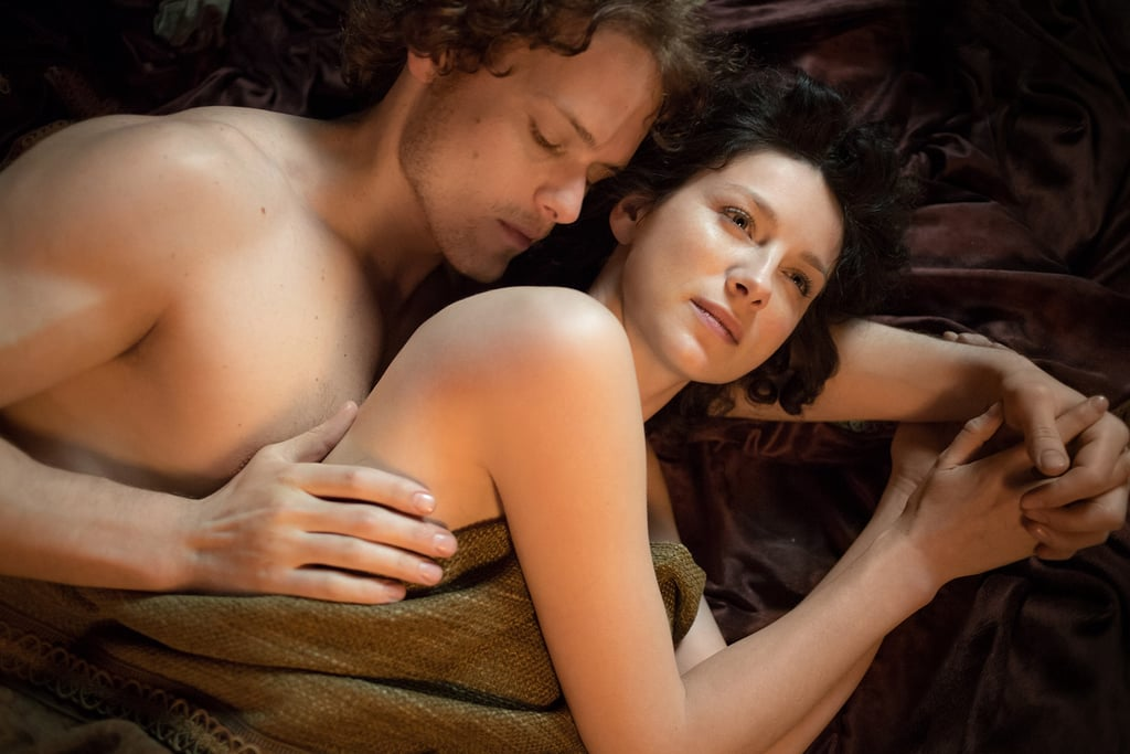 Jamie and Claire cuddle up.