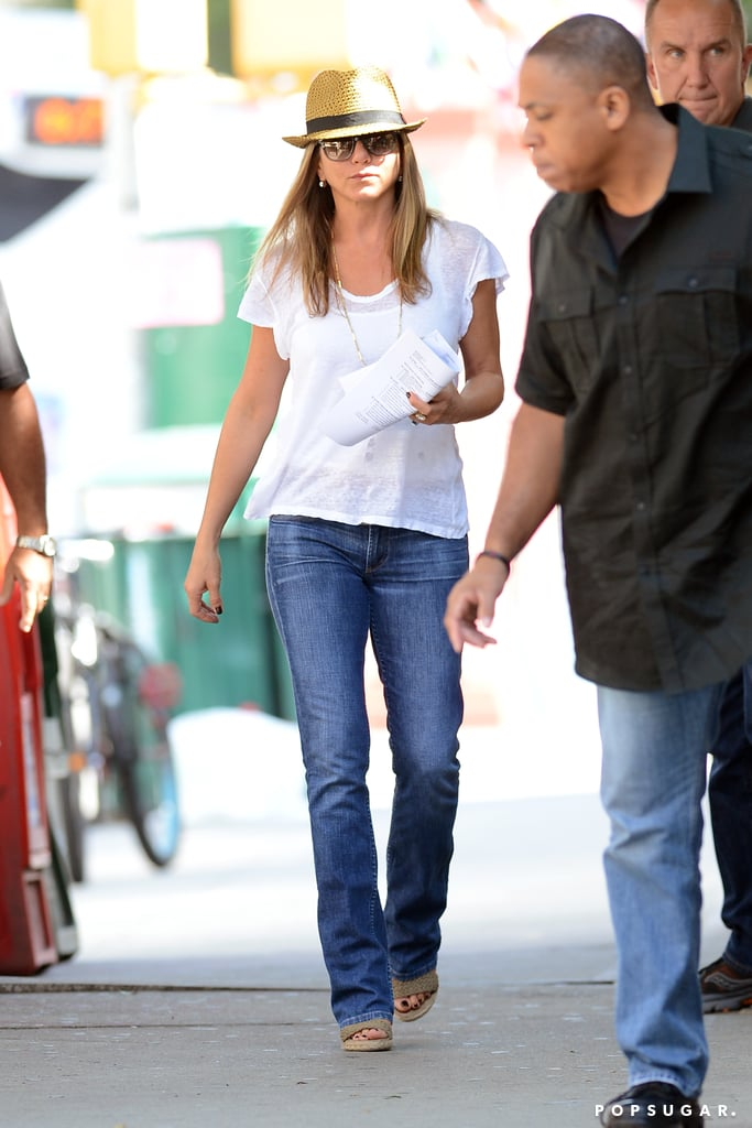 Jennifer Aniston wore a white t-shirt and fedora on her NYC set on July 31.