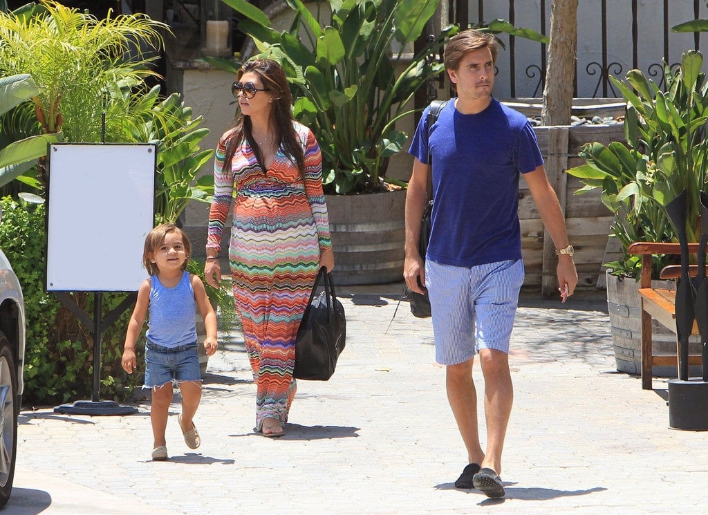 Kourtney Kardashian and boyfriend Scott Disick brought their son Mason to lunch in LA. The little one showed off California-cool style in a blue tank, denim cutoffs, and brown moccasins.