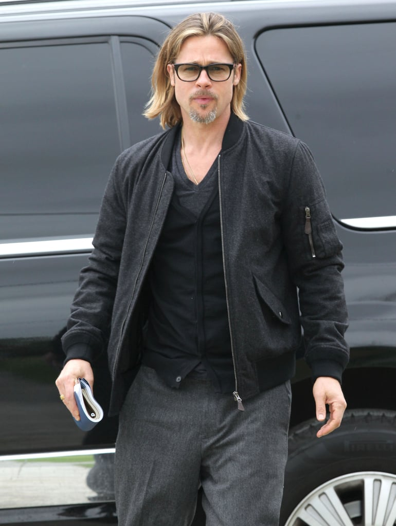 Brad Pitt wore dark rimmed glasses.