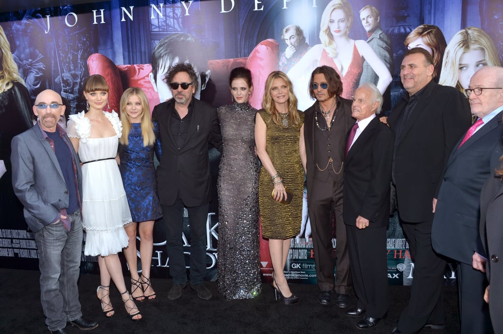 Jackie Earle Haley, Bella Heathcote, Chloe Moretz, director Tim Burton, Eva Green, Michelle Pfeiffer, Johnny Depp, and producers Richard D. Zanuck, Graham King, and David Kennedy posed together on the black carpet for the premiere of Dark Shadows in LA.