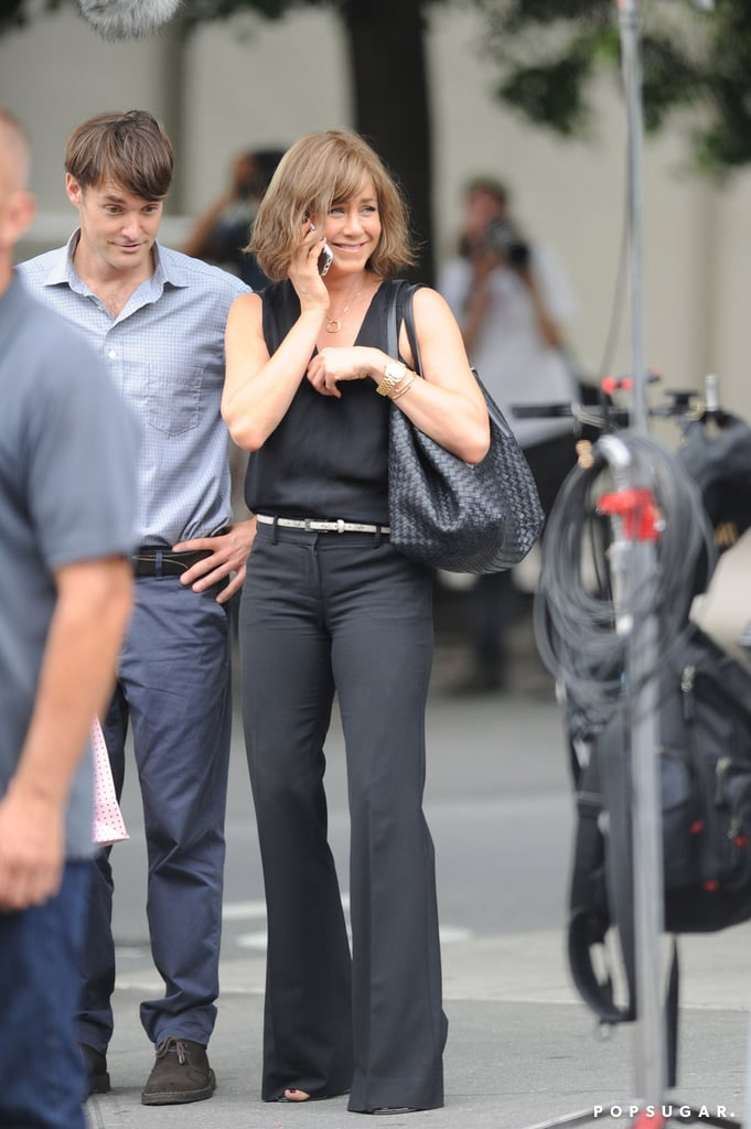 On July 17, Jennifer Aniston took a call on the NYC set of Squirrels to the Nuts.