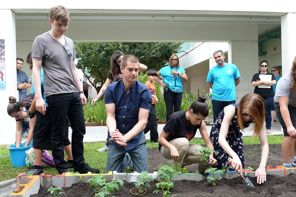 Dane, Andrew, and Emma helped plant vegetables.
