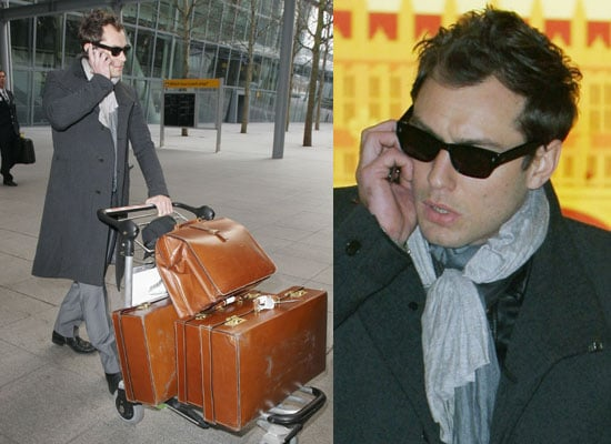 Photos of Jude Law Arriving at Heathrow Airport Watch Jude Law on Regis and Kelly Plus The Daily Show
