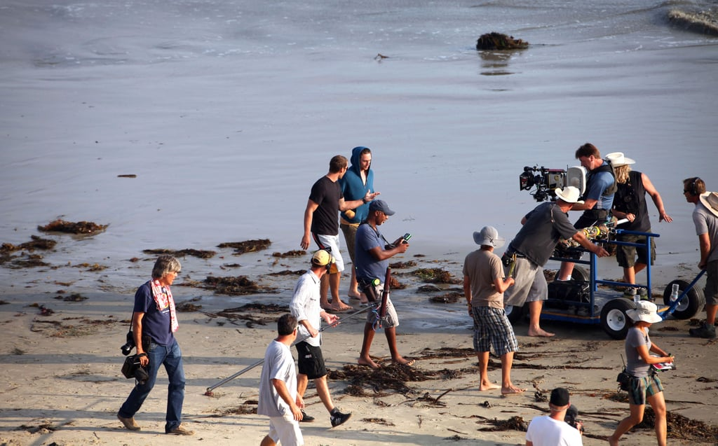 Oliver Stone set up a shot with Taylor and Aaron.