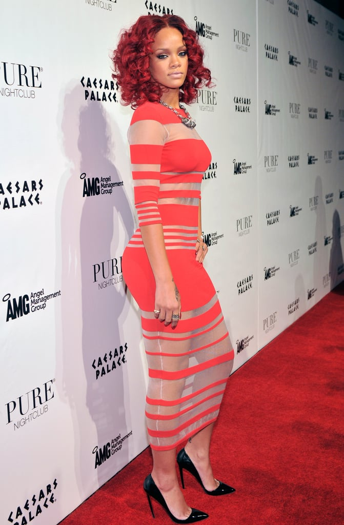 Rihanna favored stripes over sequins in this nude and red maxi dress.