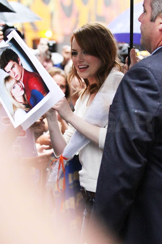 Emma signed stills from her upcoming movie The Amazing Spider-man.