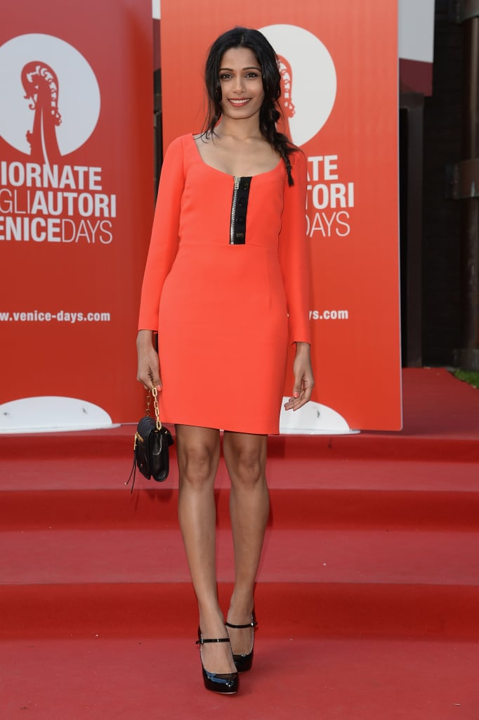 Freida Pinto brightened up the red carpet premiere for Miu Miu Women's Tale in a hot orange minidress, accompanied with black, patent Mary Janes and a black mini bag.