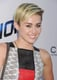 As Miley's hair grows longer, she's been wearing her undercut in a combed-over style as opposed to up in a pompadour.