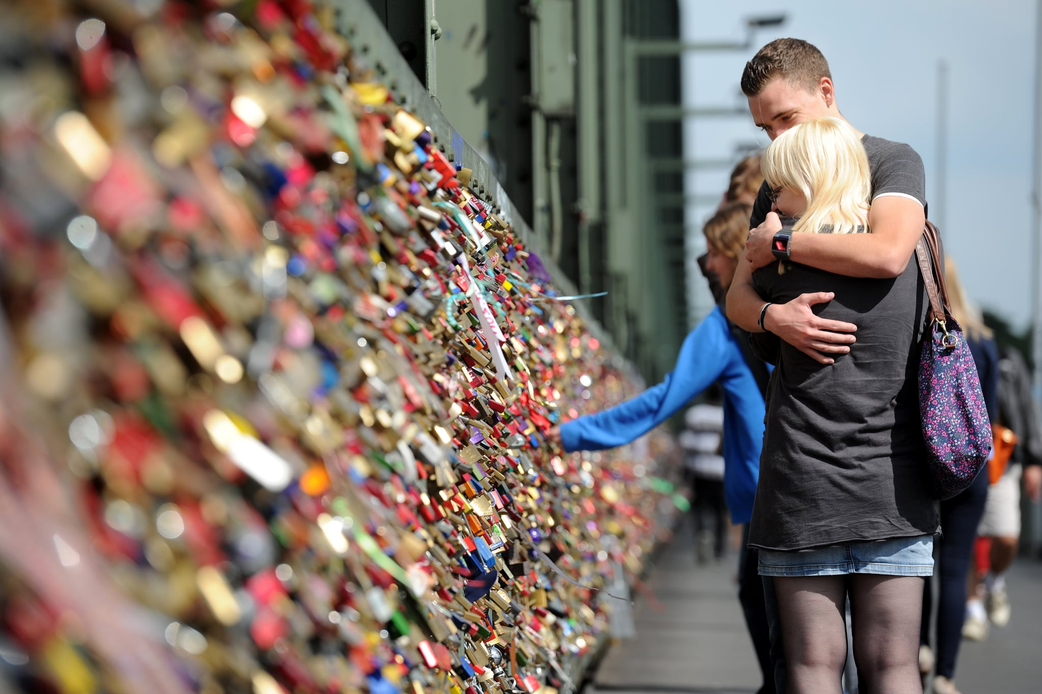 A couple embraced after affixing their lock to the bridge in Germany.