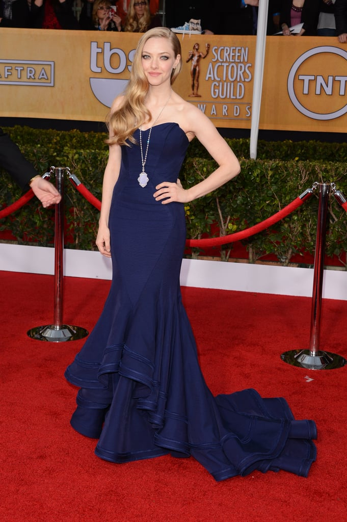 Amanda Seyfried's strapless navy Zac Posen was sleek up top and beautifully frothy on bottom.