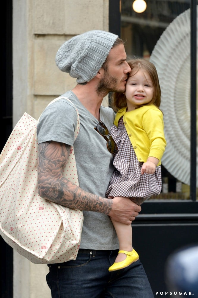 David Beckham showered Harper in kisses during her visit to Paris to celebrate his 38th birthday.