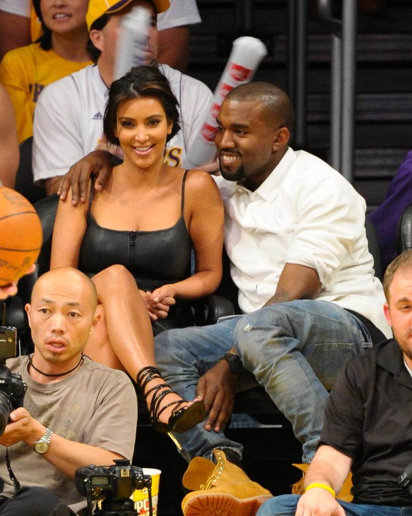 Kanye had his arm around Kim and a smile on his face at a May 2012 Lakers game in LA.