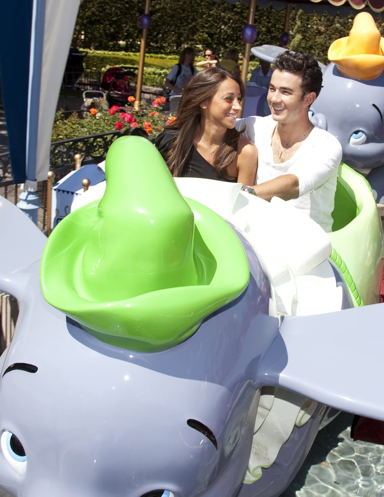 Kevin and Danielle Jonas shared a seat on the Dumbo ride in April 2011.