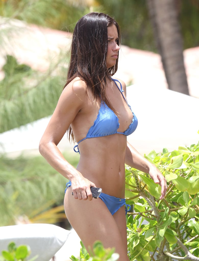 Adriana Lima put her fit physique on display for the cameras during a photo shoot.
