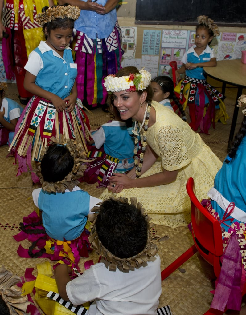 Kate was happy to sit on the floor and play with a group of kids at the Nauti Primary School in Tuvalu. She even got decked out in the locals' tradition garb during the couple's Diamond Jubilee tour stop in September 2012.
