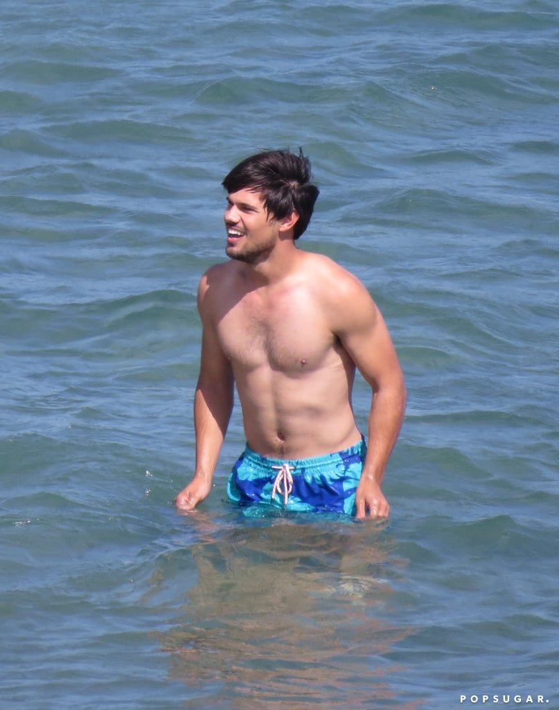 Taylor Lautner splashed around shirtless on the LA set of Run the Tide on Tuesday.