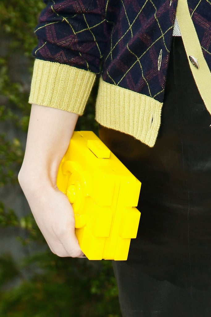 A close-up on Hailee Steinfeld's bright yellow box clutch.