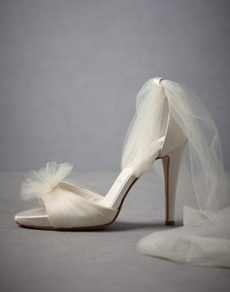 The tulle detailing make these feel like the footwear for a modern fairytale — perfect for adding to your more glamourous gowns.  BHLDN Auroral Vapor Heels ($350)