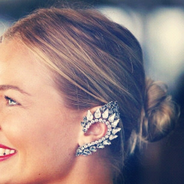 Lara Bingle showed off her amazing ear cuff, which replaced the standard fascinator or hat at the Caulfield Cup. Source: Instagram user mslbingle