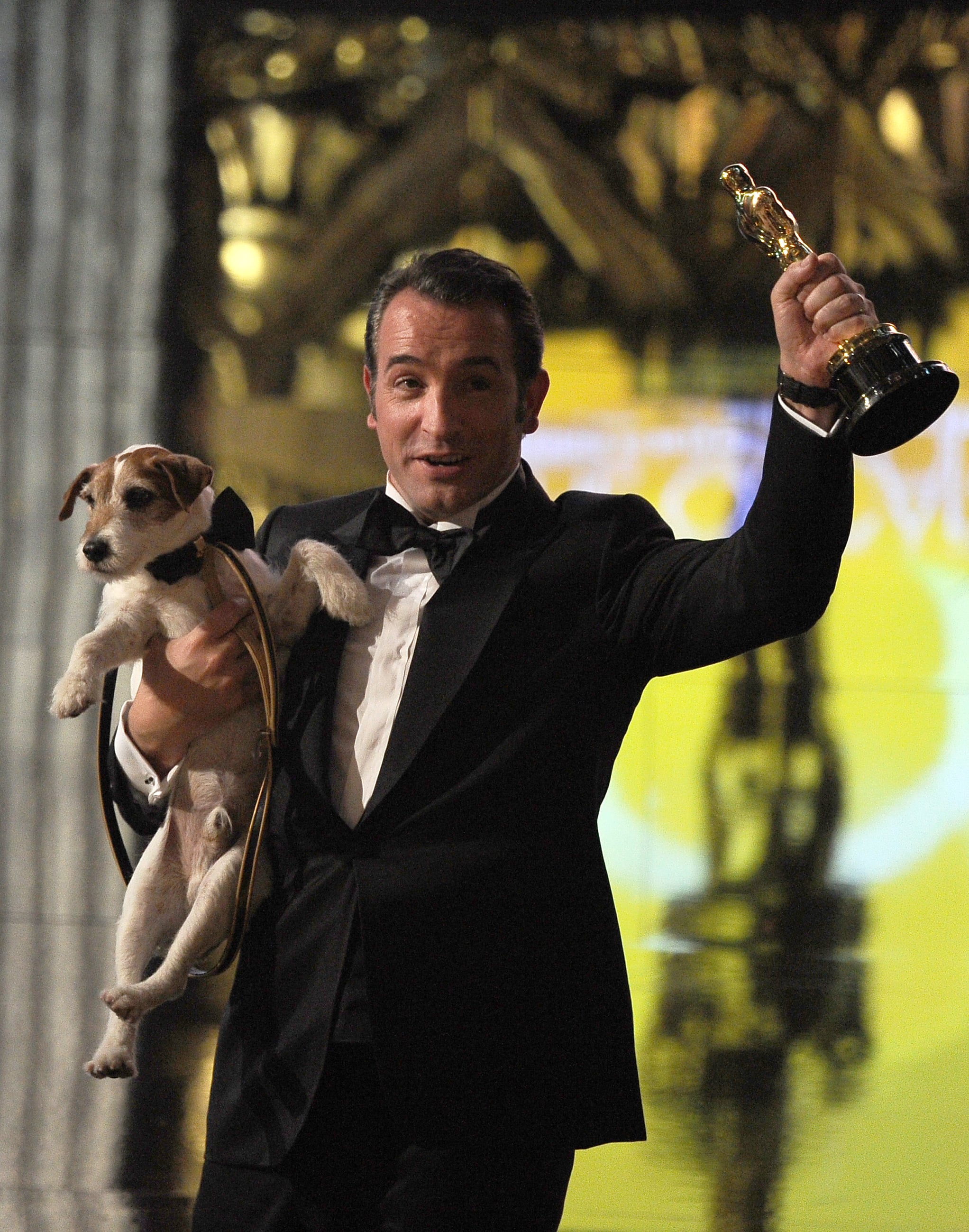 With best actor-winning costar Jean Dujardin. Source: AFP