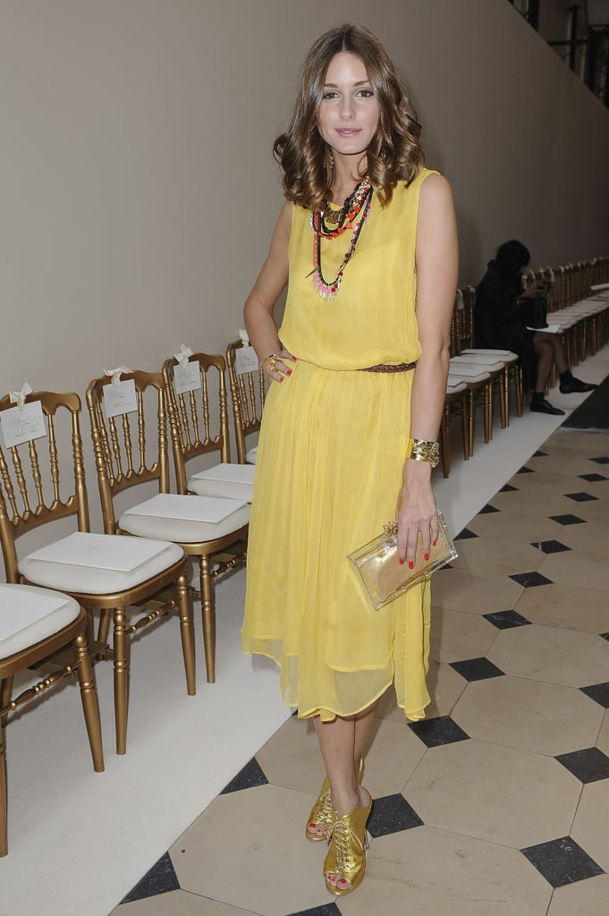 Olivia Palermo in Topshop dress, Giuseppe Zanotti shoes, and Charlotte Olympia clutch