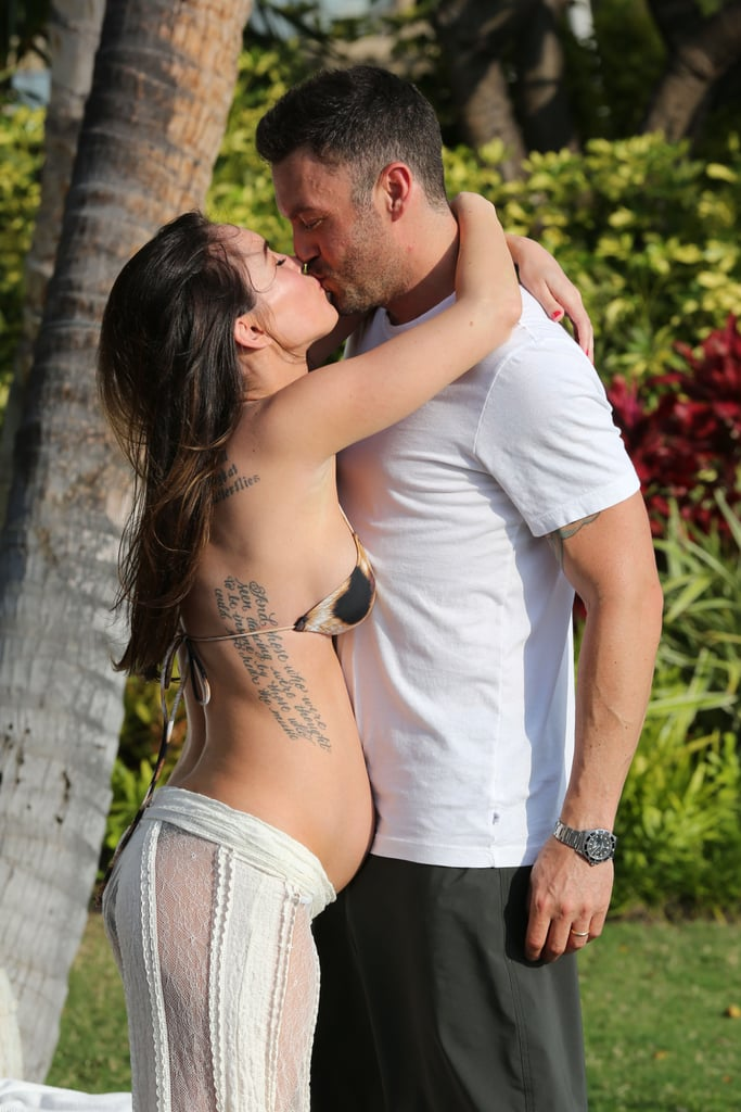 Megan Fox's pregnant belly was on display in a bikini as she kissed BAG.