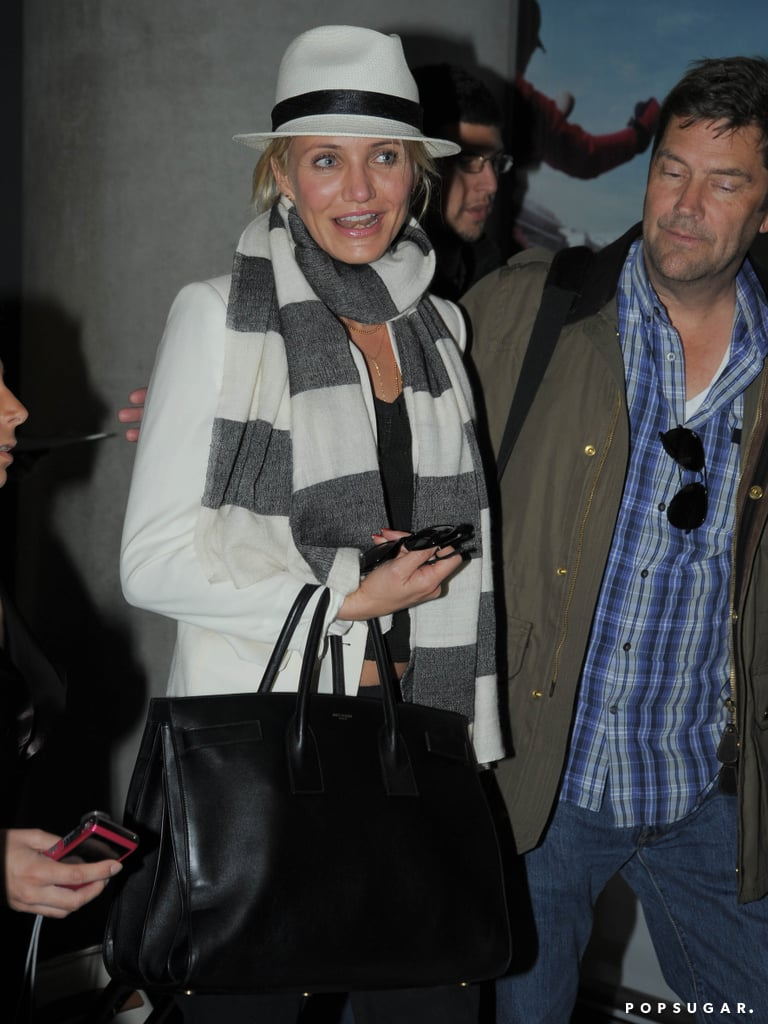 Cameron Diaz covered up in a hat and a striped scarf.