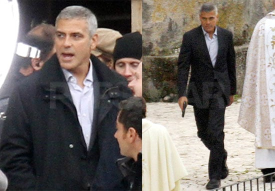 Pictures of George Clooney on the Set of The American Holding a Gun