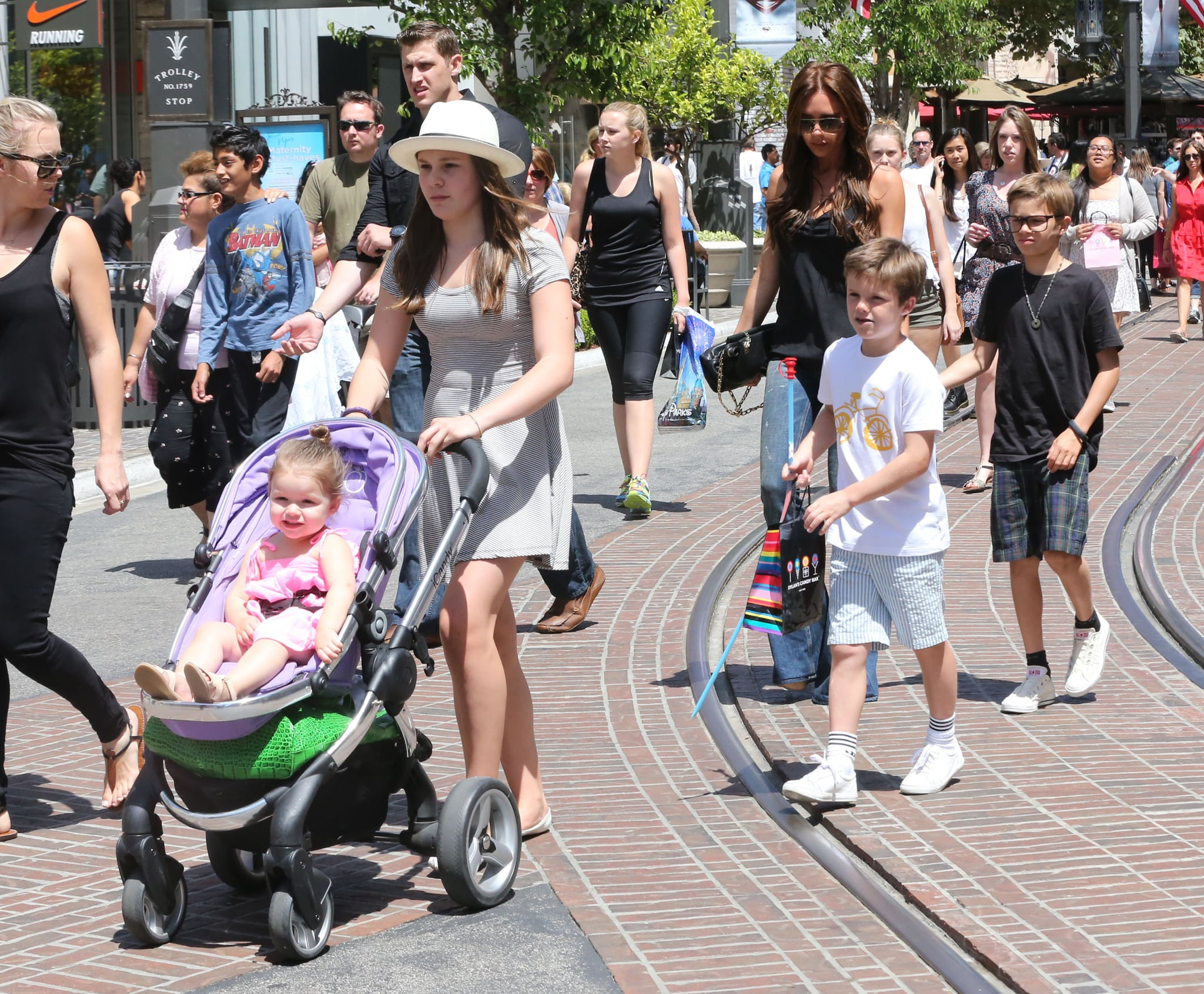 Victoria Beckham walked through The Grove shopping mall in LA with her kids.