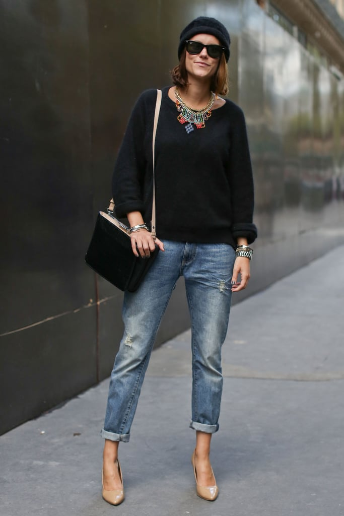 Baggy jeans feel entirely chic when you add statement jewels and heels like so.