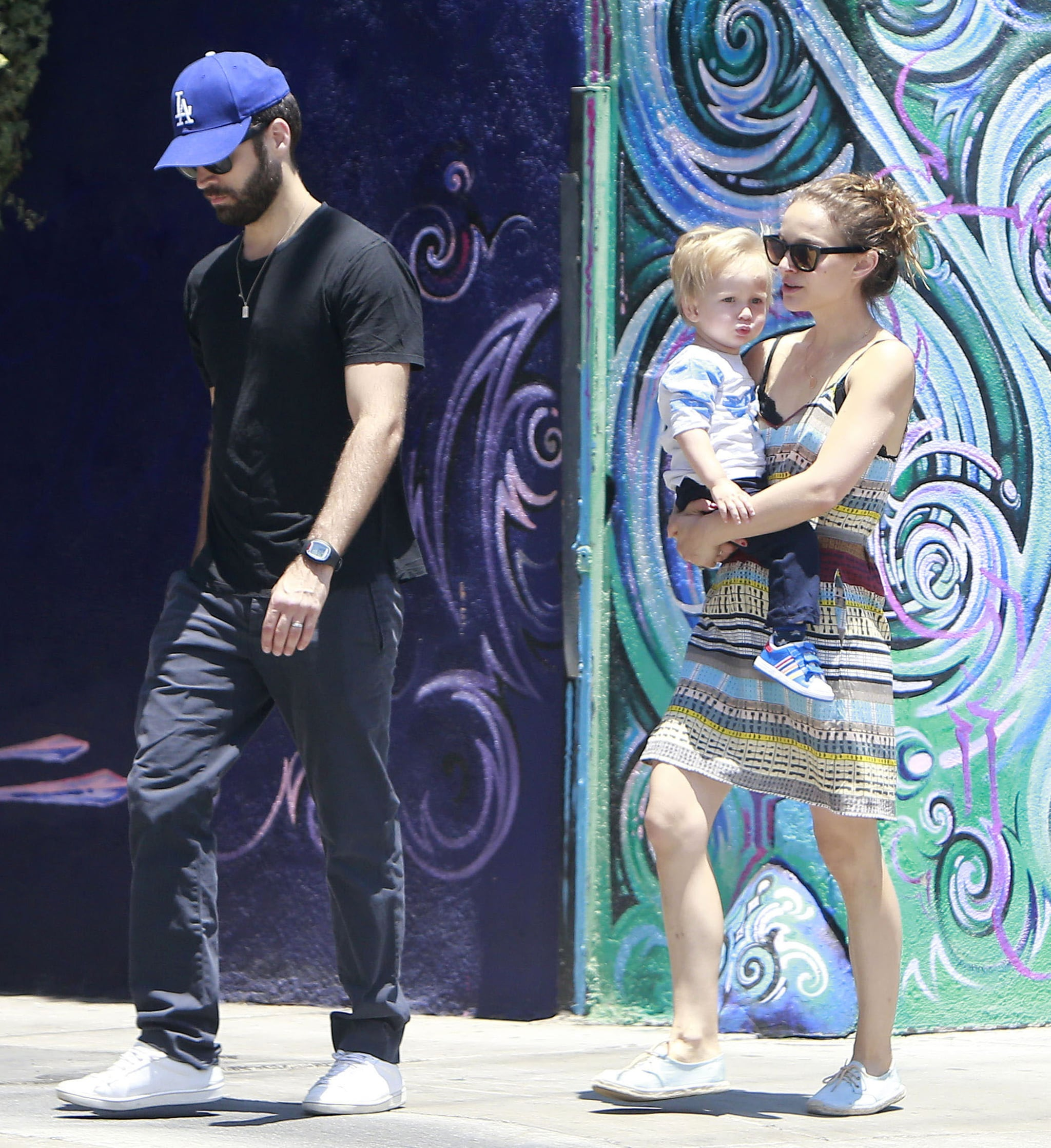 Natalie Portman carried Aleph down the street.