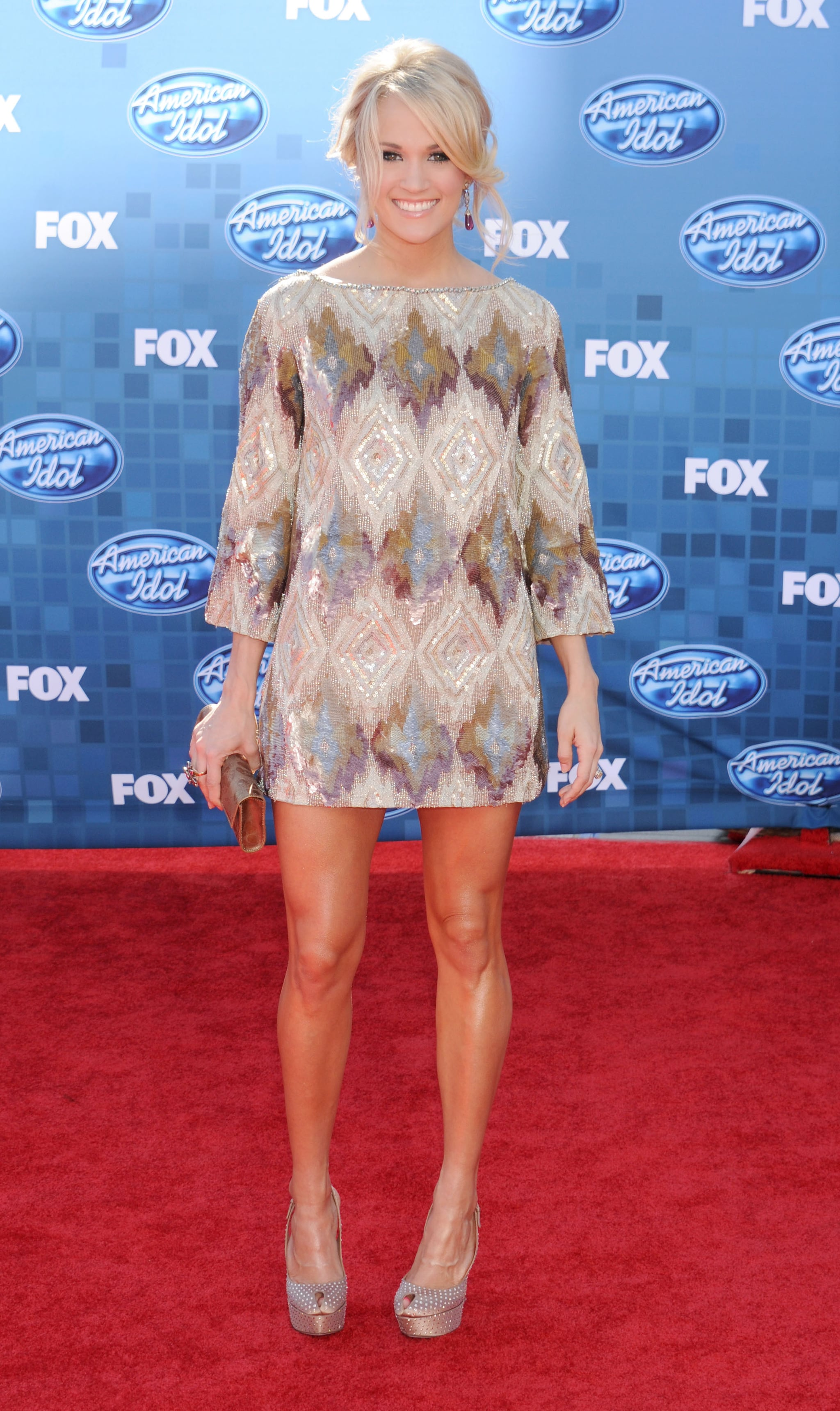 Carrie Underwood showed off her gorgeous gams in a beaded Lorena Sarbu mini at the 2011 finale of American Idol. She accessorized her leg-baring dress with embellished Sergio Rossi pumps and champagne clutch.