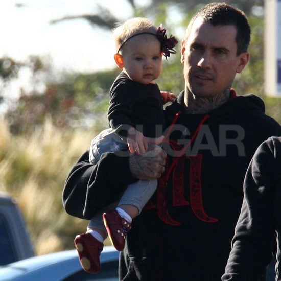 Willow Hart was happy to ride along in dad Carey Hart's arm.