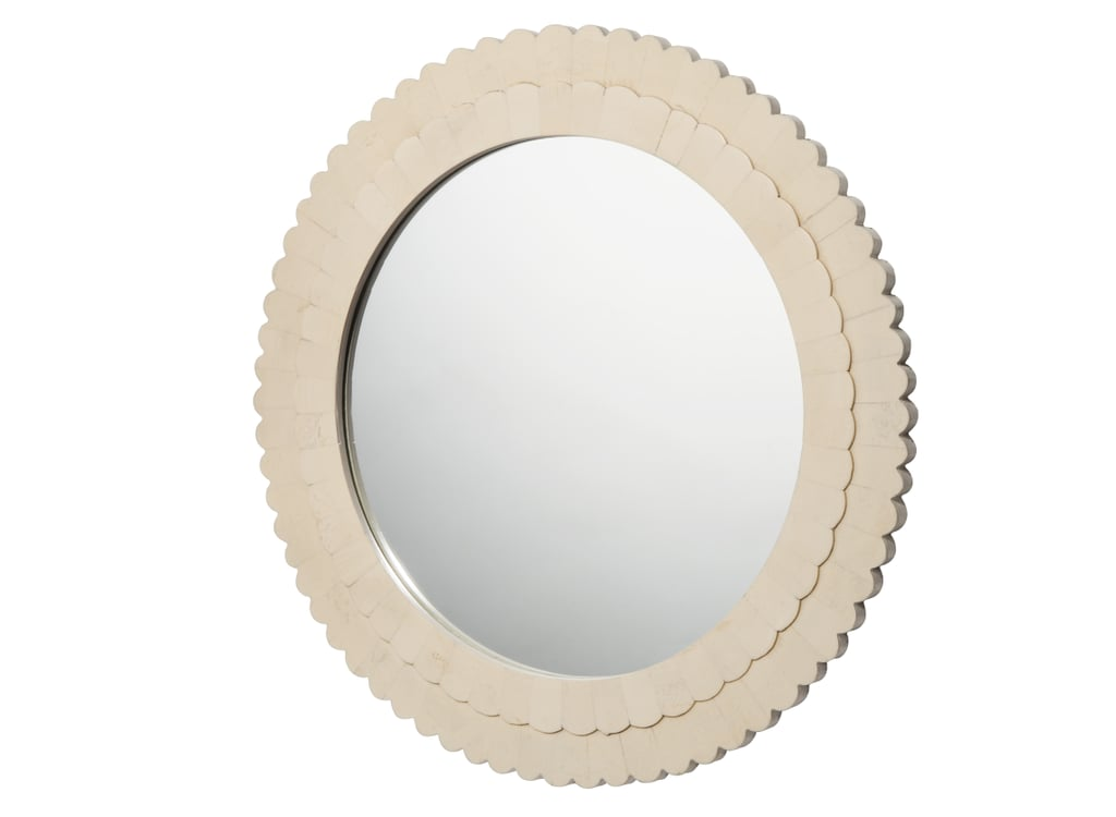 The scalloped edges on this mirror ($40) feel feminine but sophisticated, thanks to the creamy color.