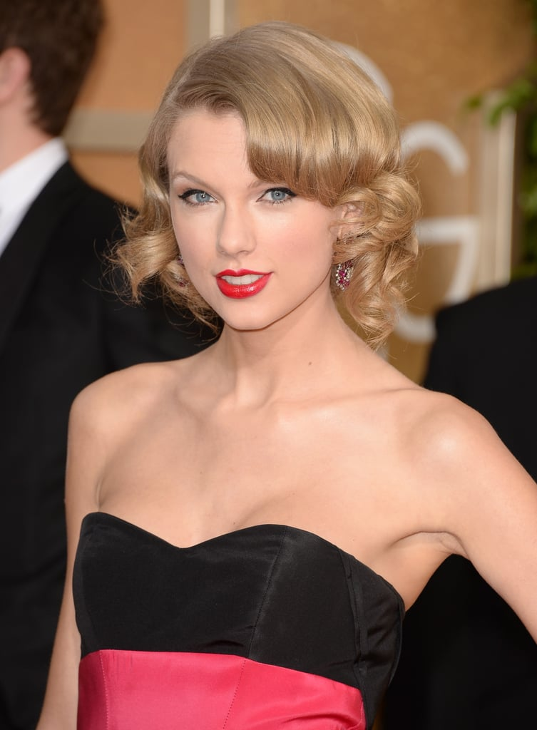 Taylor Swift was a modern-day princess sporting a classic cat eye and extraglossy red lips.