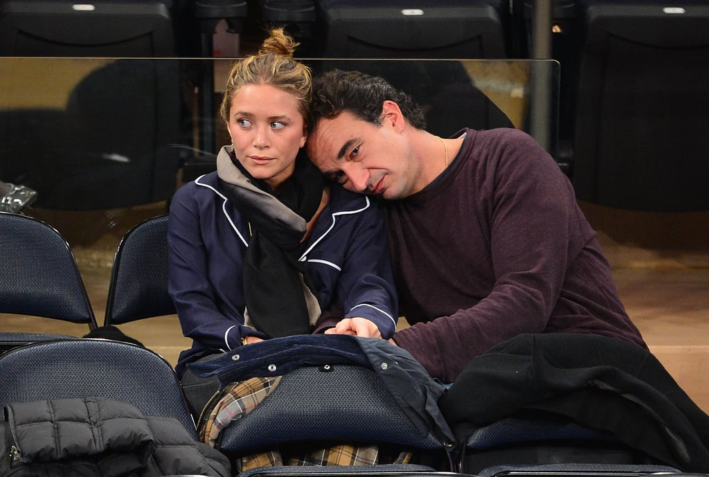 Mary-Kate Olsen and Olivier Sarkozy were loved up at the New York Knicks game.