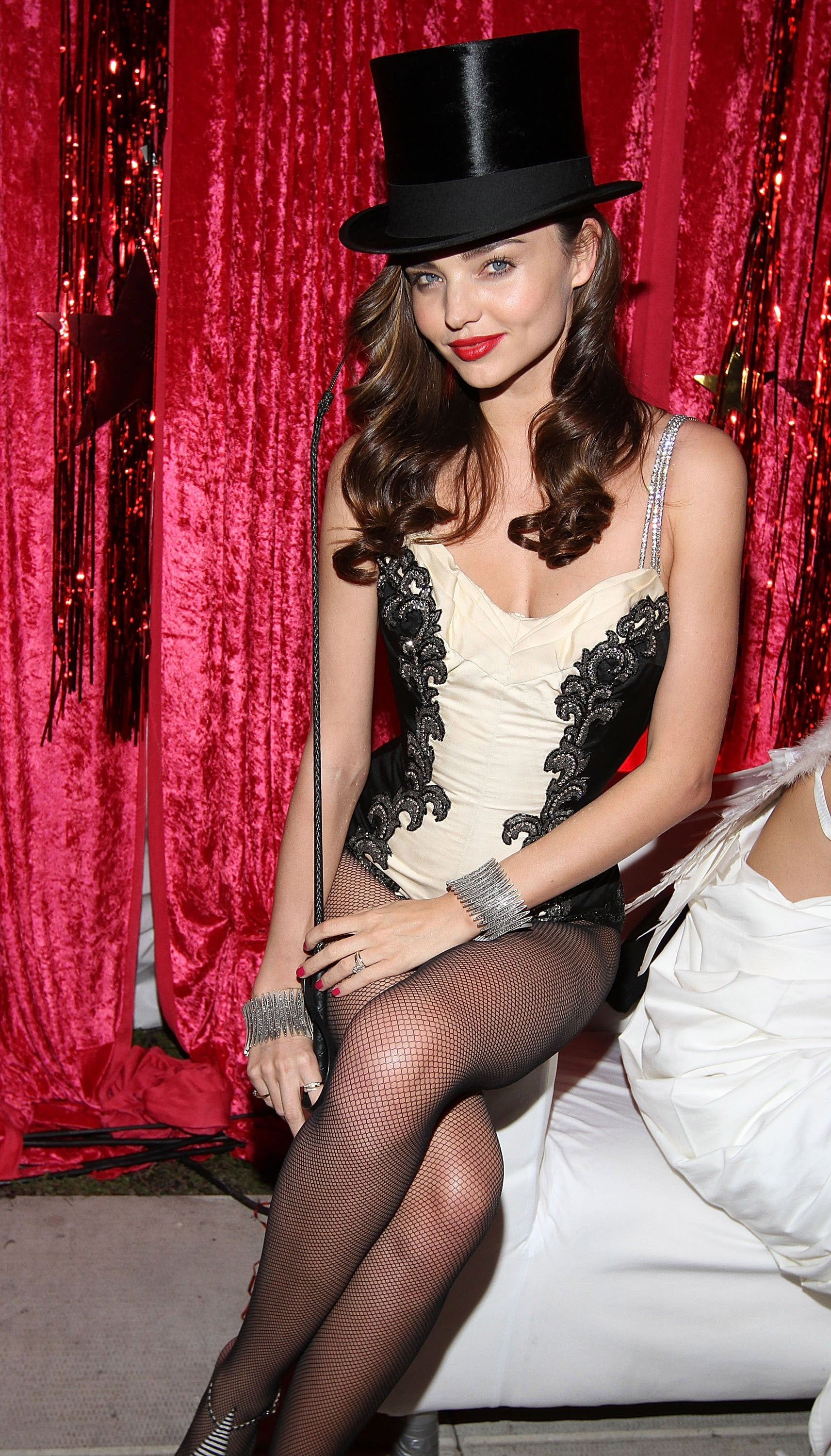 Miranda Kerr took a seat at her NYC rooftop Halloween party.