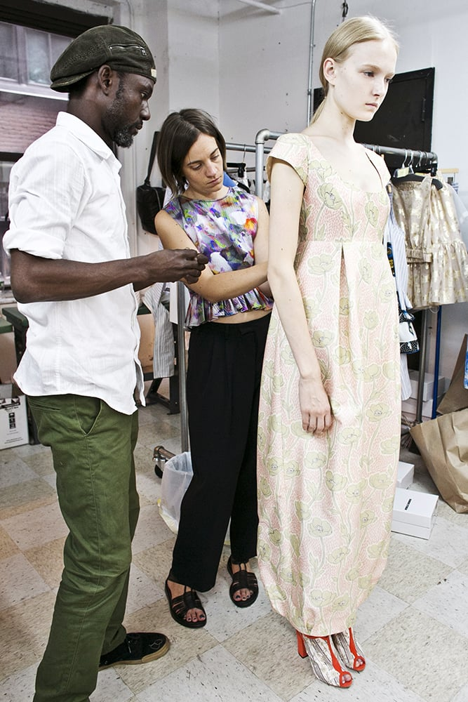 It's just over 24 hours before show time. While the designers and beauty teams have been in touch for weeks, today's when the total look comes together. While the hair and makeup teams set up to create the test looks, Suno's Erin Beatty tailors a dress to fit a model precisely.