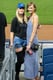 Anne V. and Karlie Kloss chose to sport Yankees blue their own way, with a baseball cap and striped maxi.