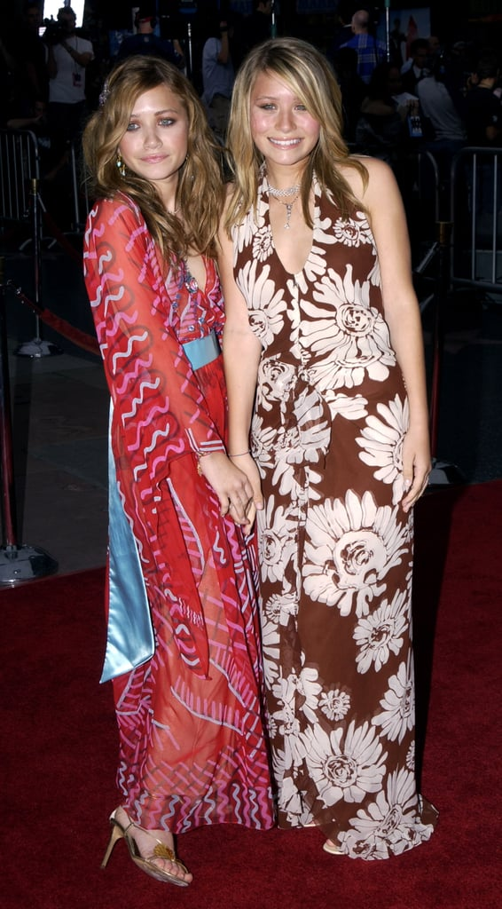 Twinning combo: The girls had us dreaming of the tropics at the Charlie's Angels 2 — Full Throttle Hollywood premiere in 2003.  Mary-Kate turned heads in a vibrant, geisha-inspired wrap dress, gold sandals, and an embellished hairpin. Ashley chose a floral halter dress and two diamond necklaces.