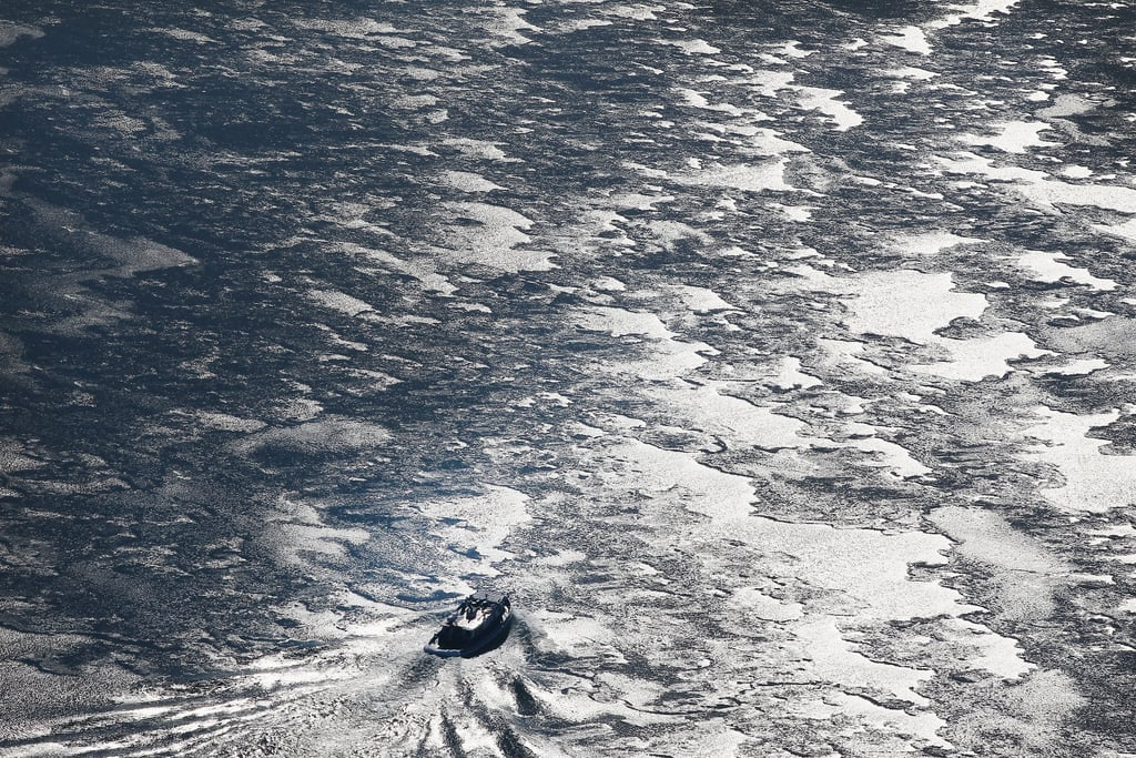 A boat broke through the ice to travel across Lake Michigan.