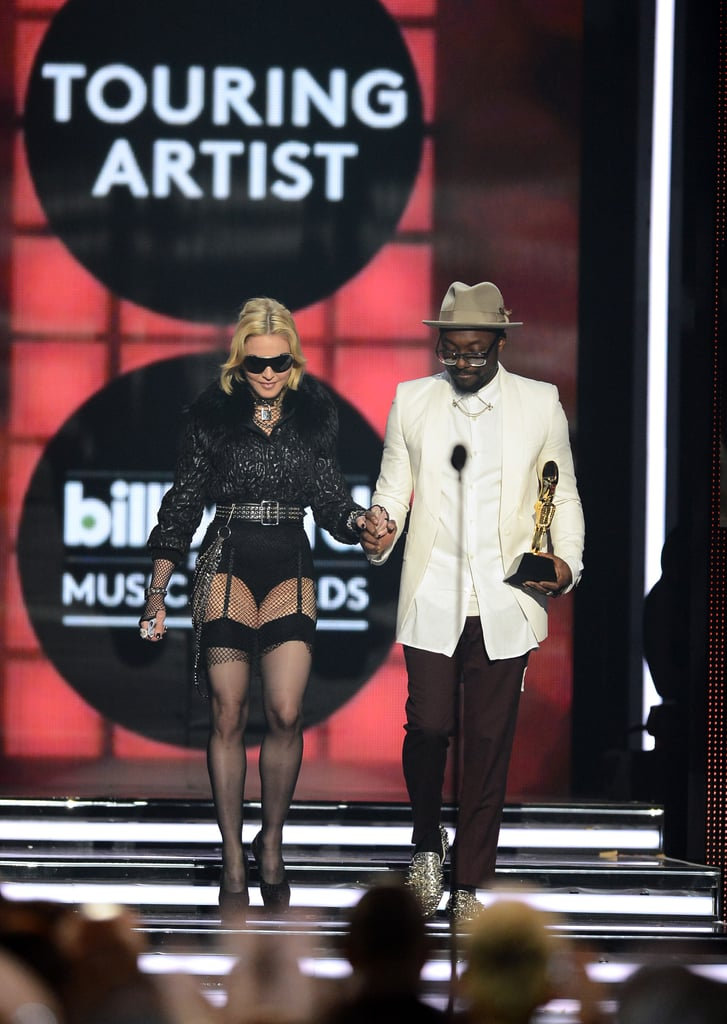 Madonna accepted the award for top touring artists alongside will.i.am.