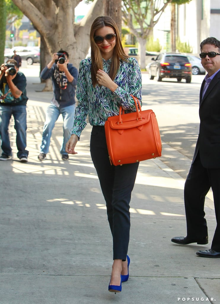 Miranda Kerr wore sunglasses with her ensemble.