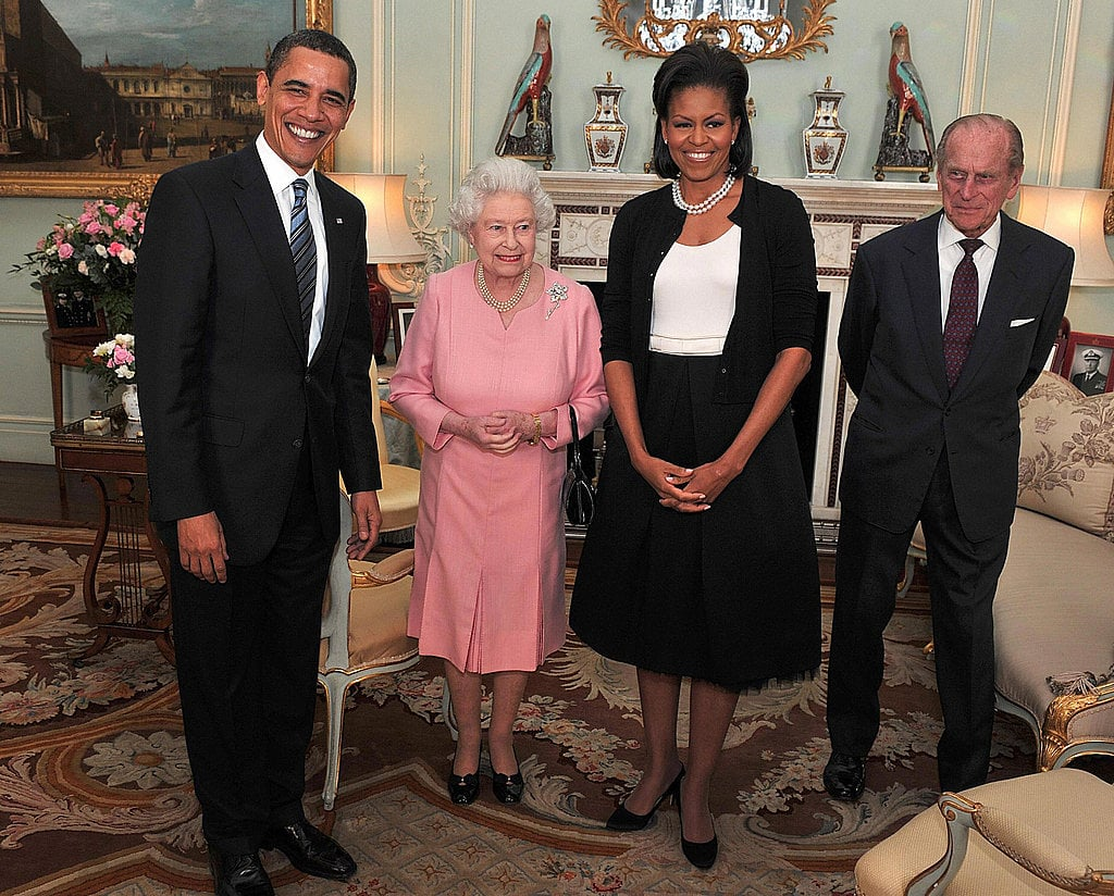During a visit with the queen, Michele's black-and-white Isabel Toledo dress was layered with an Alaia black cardigan.