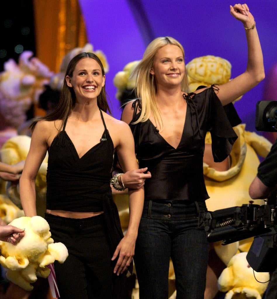 Charlize Theron and Jennifer Garner were arm in arm for the 2002 show.